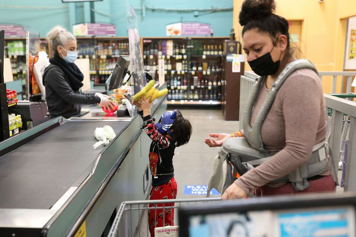 Aracely Nava with her son Fares Arriaga, 3, shop for groceries in Richmond. Nava said she was afraid of virus contagion while she worked at a San Francisco fast-food restaurant during the pandemic.