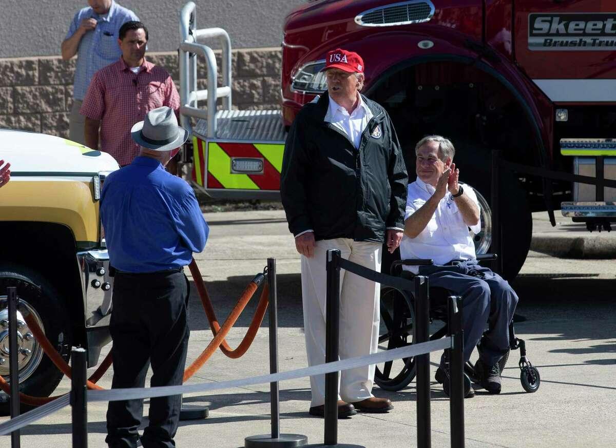 President Donald J. Trump and Gov. Greg Abbott, upper left corner, greeting Hurricane Laura first responders Saturday, Aug. 29, 2020, at Orange County emergency center in Orange.