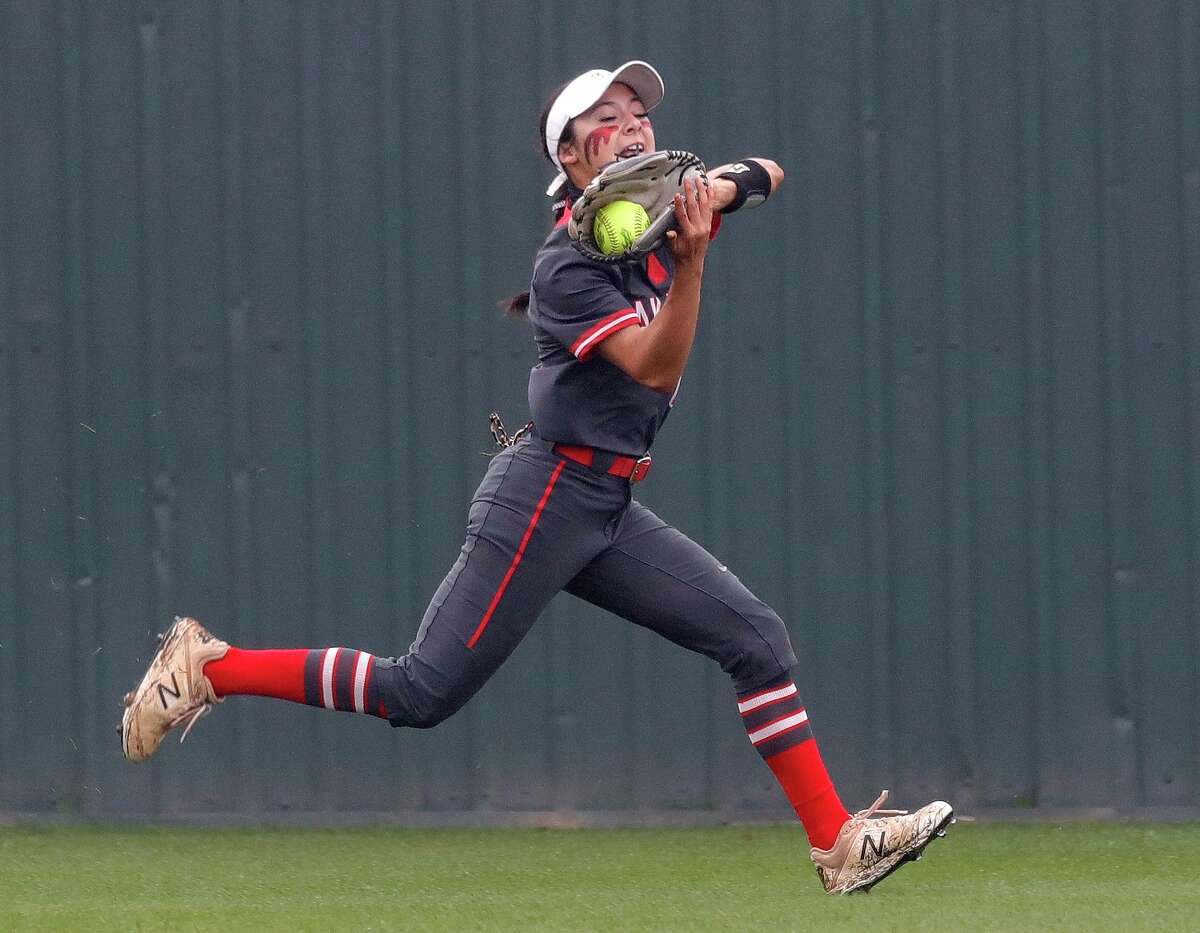 FILE - Oak Ridge left fielder Kaitlynn Martinez (1) makes a catch on a hit by Lainey Niederhofer #5 of Willis during the fifth inning of a District 13-6A high school softball game at Willis High School, Friday, April 16, 2021, in Willis.