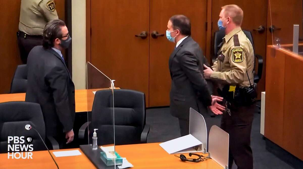 As his attorney Eric Nelson, left, looks on, former Minneapolis police officer, Derek Chauvin, is handcuffed and taken into custody after being found guilty of all charges in the death of George Floyd, in Minneapolis on Tuesday, April 20, 2021. (Pool Video Via Court TV/PBS News/Zuma Press/TNS)