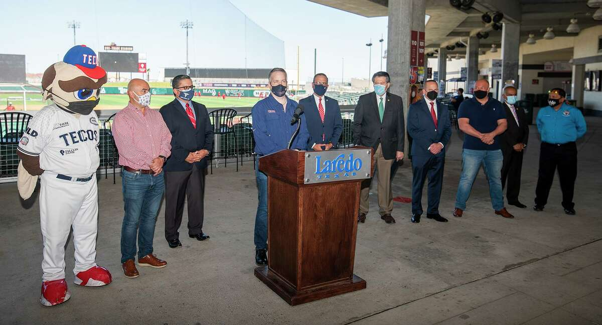 Tecolotes Dos Laredos general manager Cuitlahuac Rodriguez, fourth from left, is joined by other team officials, City of Laredo leadership and health experts on Tuesday to announce the return of the Tecos and highlight the safety precautions the team is taking this season.