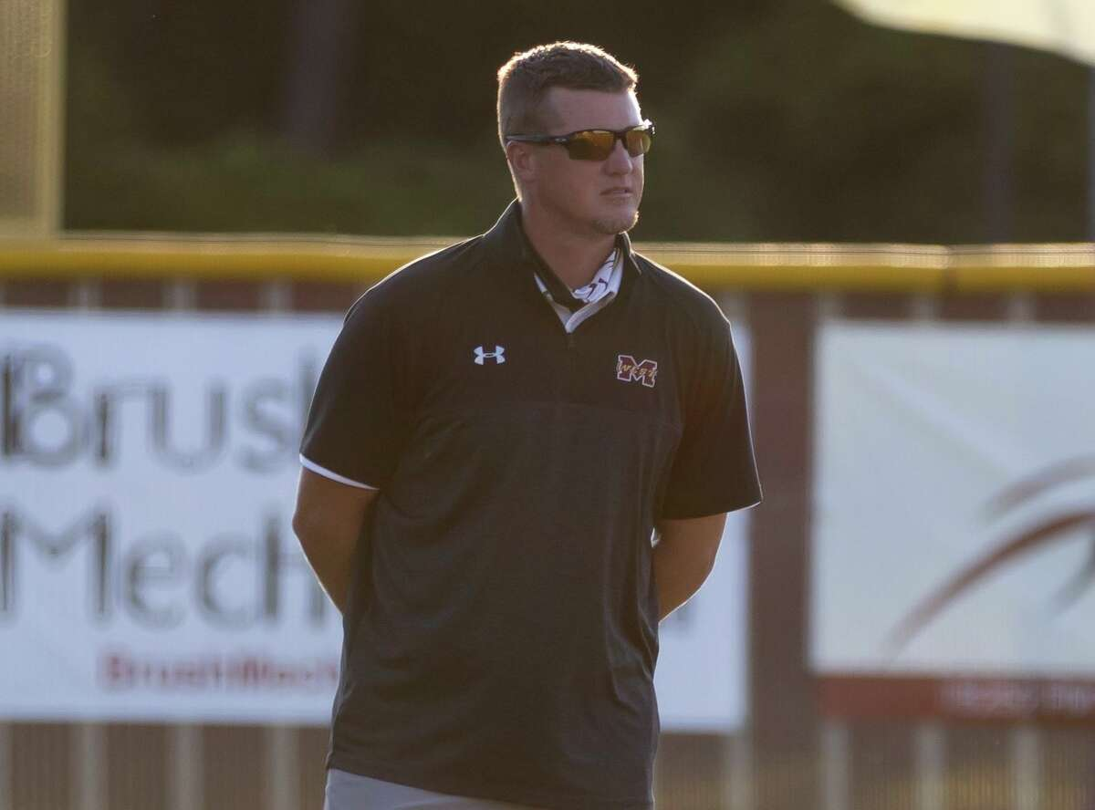Magnolia West head coach Jeremy Collins watches a play during the first inning of a District 19-5A softball game against Magnolia at Magnolia West High School, Tuesday, April 20, 2021, in Magnolia.