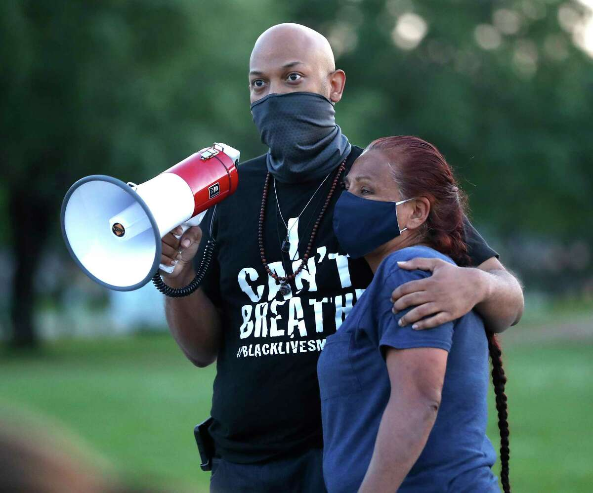 Ashton Woods hugs Janie Torres, sister of José Campos Torres, who was killed by police in Houston in 1977 during a vigil at MacGregor Park after they learned the guilty verdict on all counts in the murder trial of former Minneapolis Officer Derek Chauvin in the death of George Floyd on Tuesday, April 20, 2021, in Houston.