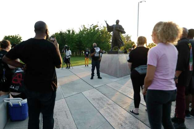 Ashton Woods leads a vigil at MacGregor Park after they learned the guilty verdict on all counts in the murder trial of former Minneapolis Officer Derek Chauvin in the death of George Floyd on Tuesday, April 20, 2021, in Houston. Photo: Karen Warren, Staff Photographer / @2021 Houston Chronicle