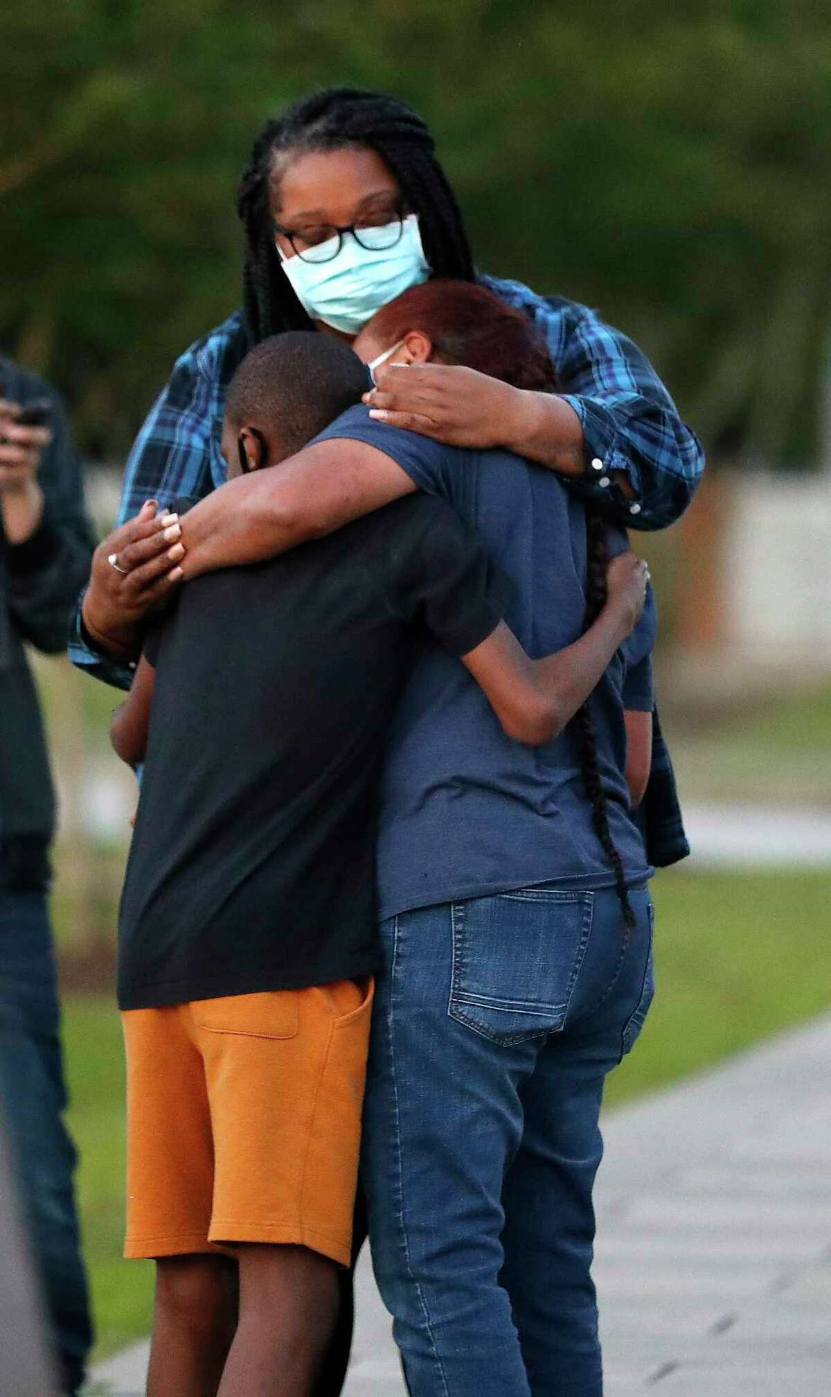Janie Torres, sister of José Campos Torres, who was killed by police in Houston in 1977 gets a hug from Rodney Henry, 11, and Nykeisha Bryer during a vigil at MacGregor Park after they learned the guilty verdict on all counts in the murder trial of former Minneapolis Officer Derek Chauvin in the death of George Floyd on Tuesday, April 20, 2021, in Houston.