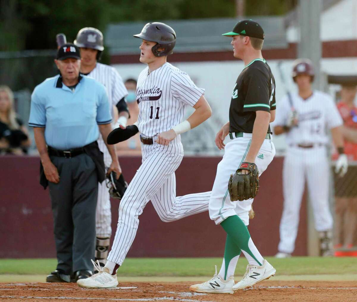 Tyce Armstrong #11 of Magnolia scores on a wild pitch from Brenham starting pitcher Ben Boose during the first inning of a District 20-5A high school baseball game at Magnolia High School, Tuesday, April 20, 2021, in Magnolia.