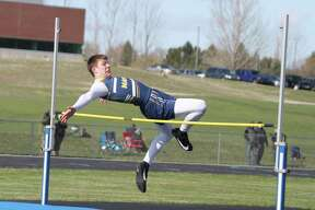 Connor Rischel competes in the high jump Tuesday during the Chippewas' season opener. (Dylan Savela/News Advocate)