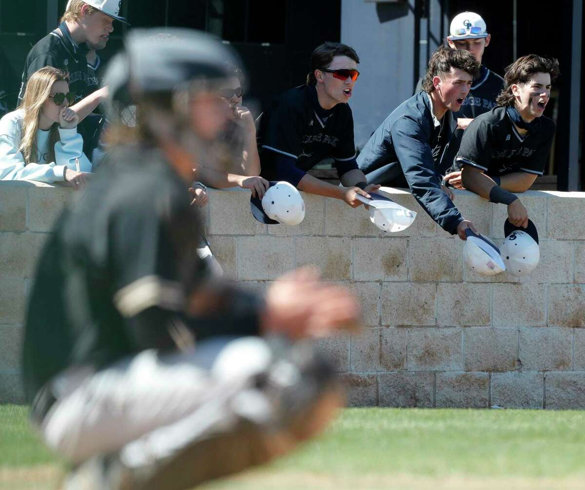 FILE - College Park players cheer on Holden Rook in the seventh inning of a District 13-6A high school baseball game at College Park High School, Friday, March 19, 2021, in The Woodlands.