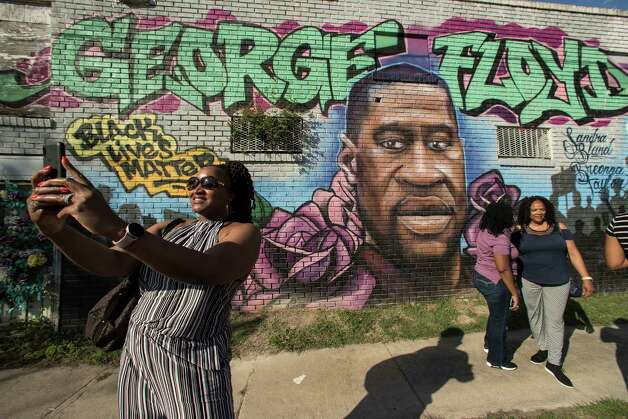 Laynette Jacob takes a photo in front of a George Floyd mural with her friends near the intersection of Elgin and Ennis as she joins others as they react after learning of the guilty verdict on all counts in the murder trial of former Minneapolis Officer Derek Chauvin in the death of George Floyd on Tuesday, April 20, 2021, in Houston. Photo: Brett Coomer, Staff Photographer / © 2021 Houston Chronicle