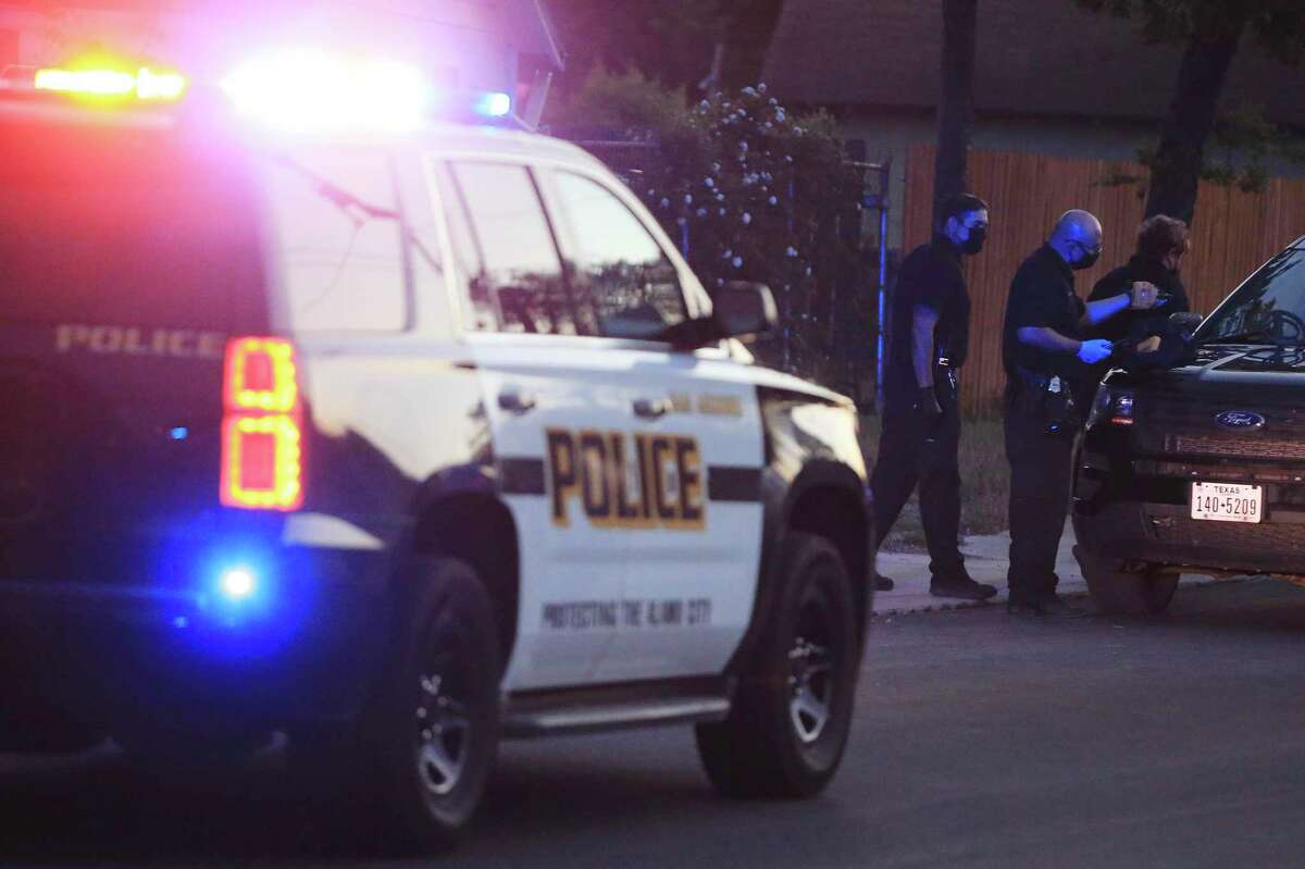 Police personnel investigate a scene after a shootout on Tuesday, April 20, 2021. San Antonio police shot and killed a man accused of gunning down another man in a shed on the South Side, police say.