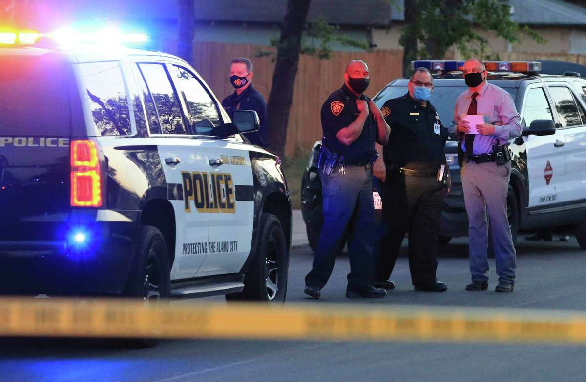San Antonio police investigate a scene after a shootout on Tuesday, April 20, 2021. San Antonio police shot and killed a man accused of gunning down another man in a shed on the South Side, police say.