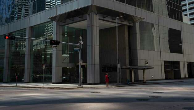 A woman waits for the traffic light at Dallas and Louisiana Streets Tuesday, April 20, 2021, in Houston. Photo: Yi-Chin Lee, Staff Photographer / © 2021 Houston Chronicle