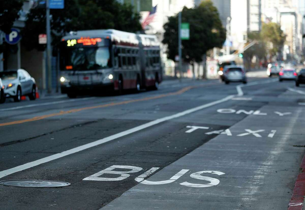 Muni says its emergency transit-only lanes like this one along Mission Street have improved bus travel times. Now the agency will implement high-occupancy-vehicle lanes along two key stretches in San Francisco.