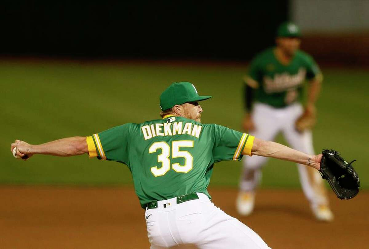 Oakland Athletics relief pitcher Jake Diekman (35) in the seventh inning during the second game of an MLB doubleheader against the Minnesota Twins at RingCentral Coliseum on Tuesday, April 20, 2021, in Oakland, Calif.