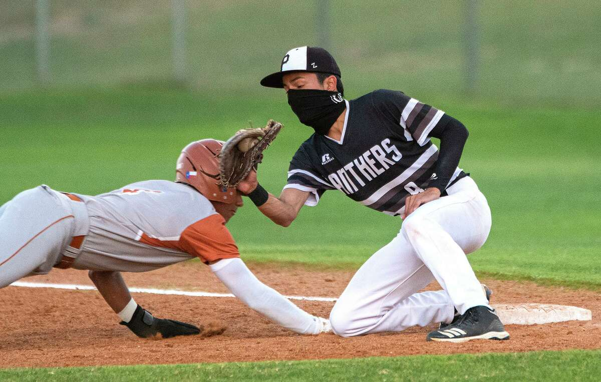 United South's Adrian Sanchez goes for the pick off during a game against Eagle Pass Tuesday, April 20, 2021 at the SAC.