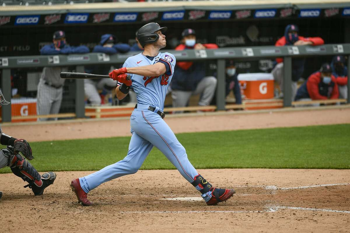 Minnesota Twins Max Kepler hits a single to center field to drive in the winning run during the ninth inning of a baseball game against the Boston Red Sox, Thursday, April 15, 2021, in Minneapolis. The Twins won 4-3. (AP Photo/Craig Lassig)