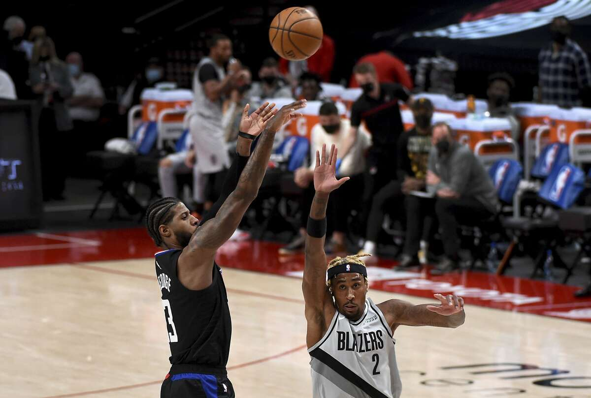Clippers guard Paul George shoots over Trail Blazers forward Rondae Hollis-Jefferson on his way to 33 points Tuesday.