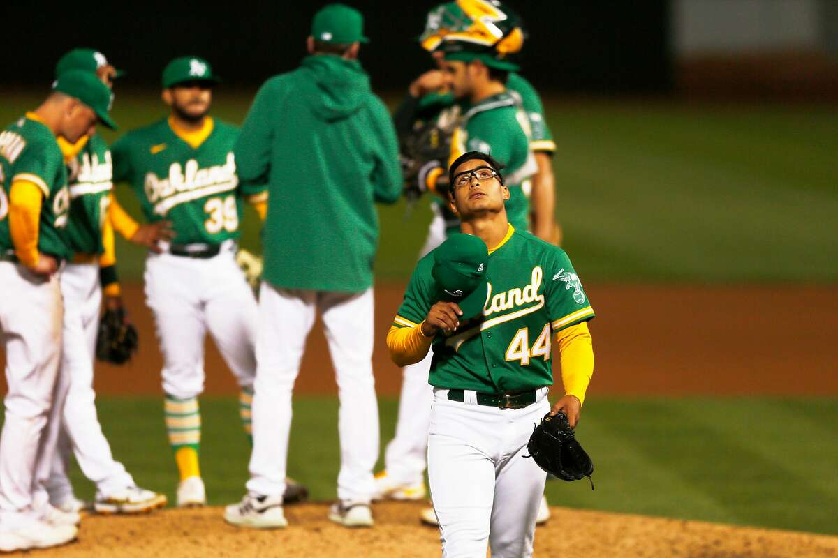 Oakland Athletics starting pitcher Jesus Luzardo (44) is taken out of the game in the sixth inning during the second game of an MLB doubleheader against the Minnesota Twins at RingCentral Coliseum on Tuesday, April 20, 2021, in Oakland, Calif.