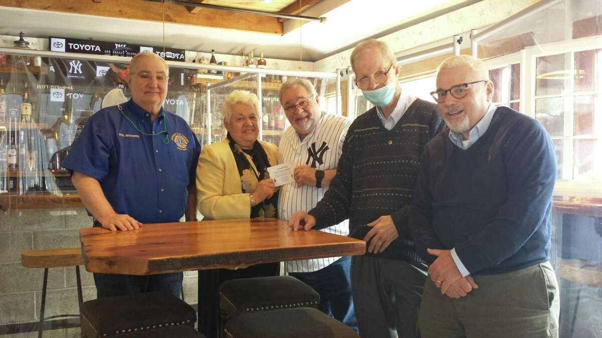 The Lions Club of New Canaan recently met at South End Uncorked Restaurant at 15 Elm St. in New Canaan, April 7, to bestow the prize on the winner of their annual Raffle. John Festo of New Canaan won four tickets to each of 12 New York Yankee home games for the 2021 Major League Baseball, (MLB), season. Pictured left to right are: Lion Paul Richards, Lion Chris Hussey, Mr. Festo, Lion David Van Buskirk and Lion Jonathan Levine.