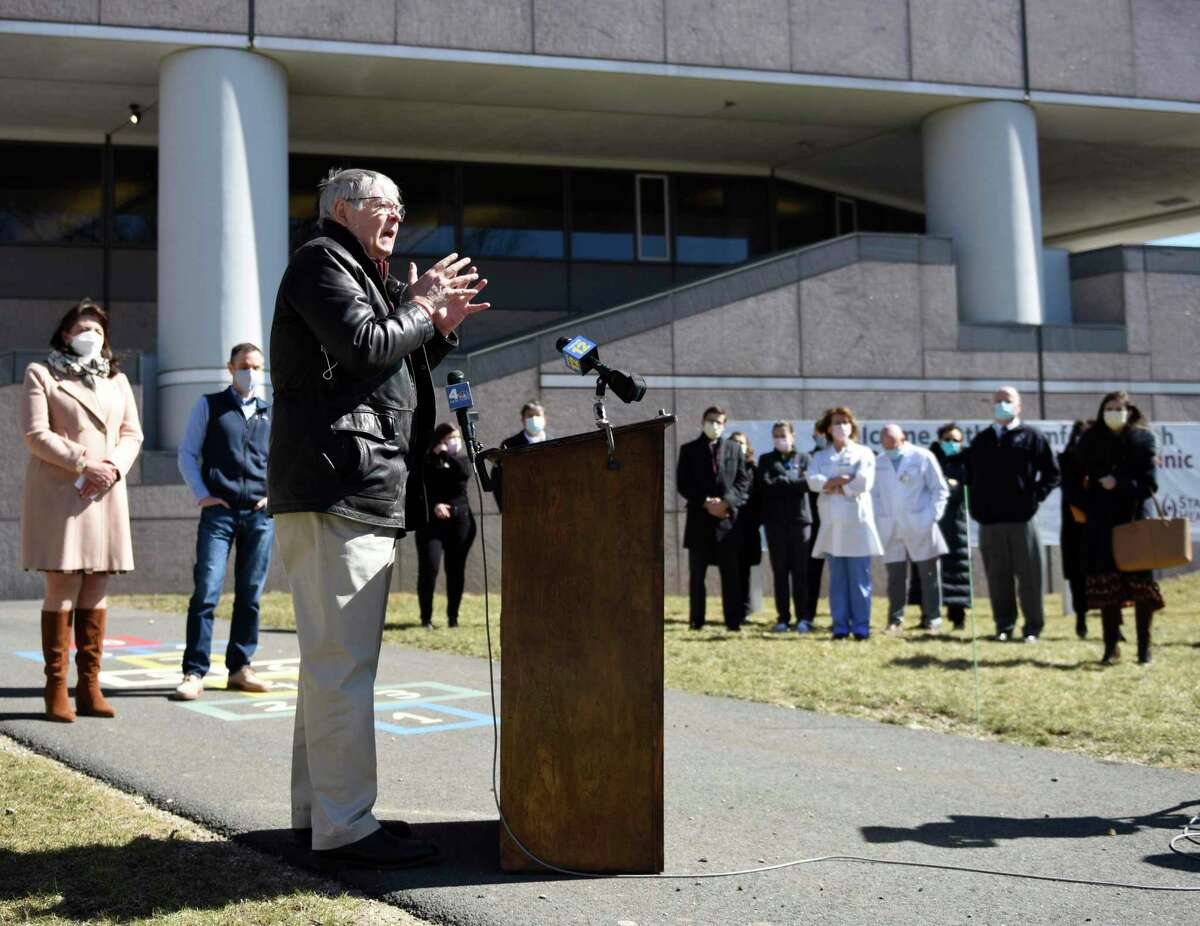 """Stamford Mayor David Martin speaks during the grand opening of the COVID-19 vaccine """"super site"""" at Silicon Harbor in Stamford, Conn. Monday, March 15, 2021."""