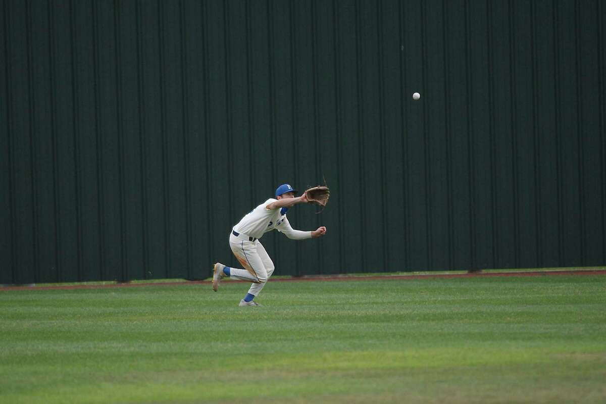 Friendswood's Kevin Newkirk (13) runs dow a fly ball against Manvel Monday at Friendswood High School.