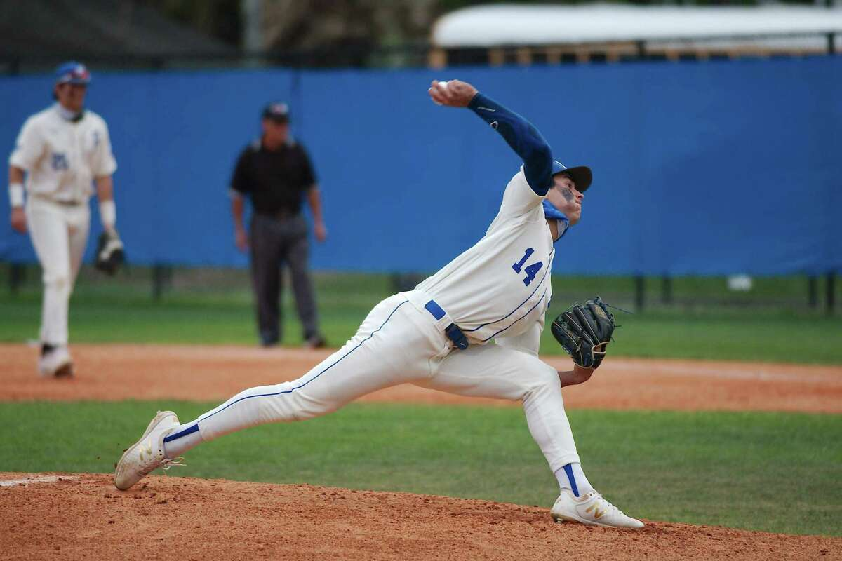 Friendswood's Jacob Rogers (14) pitches against Manvel at Friendswood High School.