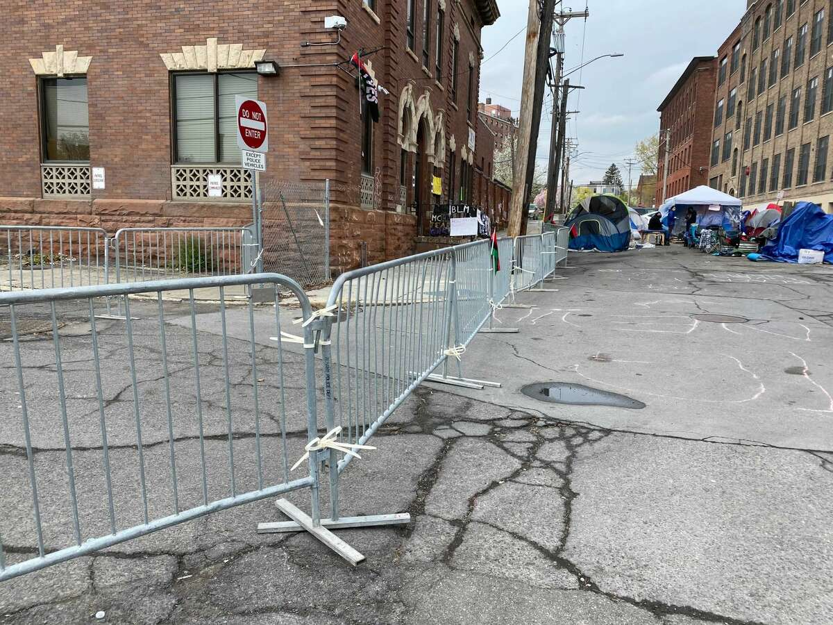 Albany city employees blocked off the sidewalks around the police department's South Station early Wednesday morning with barricade fencing.