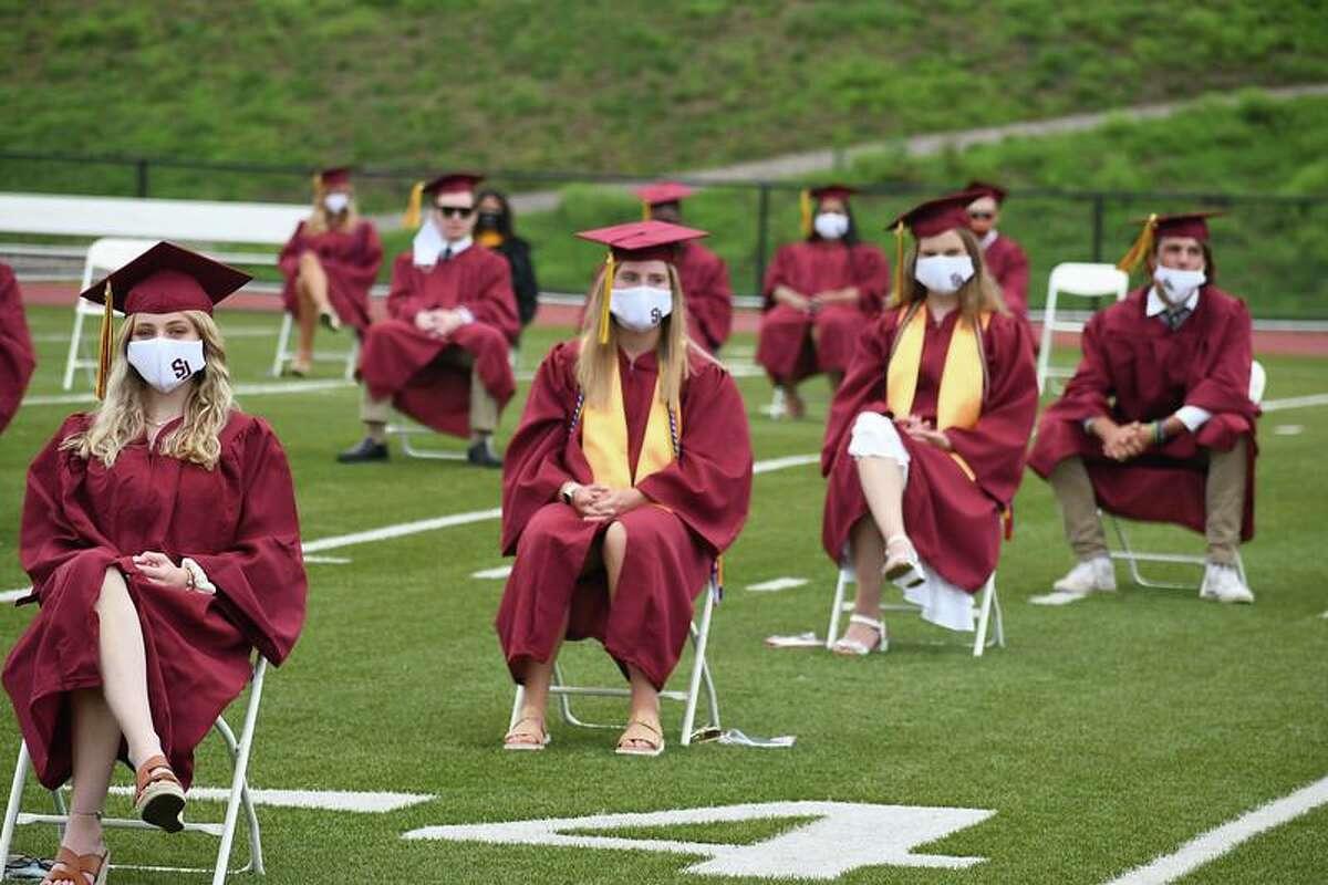 Graduates sit socially distanced during St. Joseph High School's 2020 graduation.