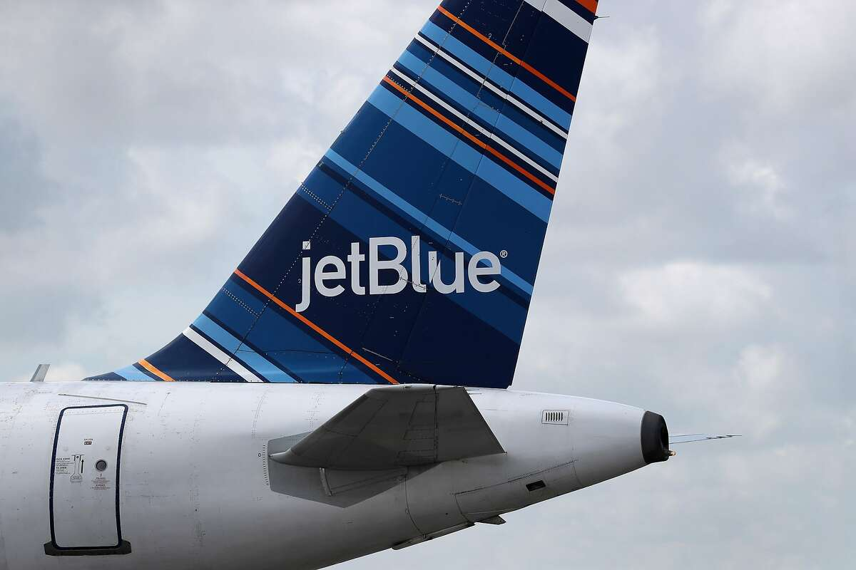 In this photo form July 16, 2020, the tail of a JetBlue plane is seen as it prepares to take off from the Fort Lauderdale-Hollywood International Airport on July 16, 2020 in Fort Lauderdale, Florida. The company has been improperly avoiding as much as $800,000 a year in property taxes. (Joe Raedle/Getty Images/TNS)