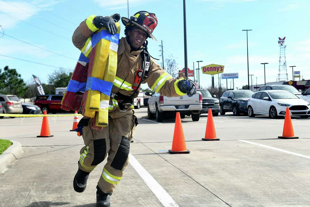The Spring Fire Department will participate in the Third Annual North Harris Firefighter Challenge on April 24. Shown here: Spring Fire Dept. firefighter Eric Marsh works the hose carry during his team's rotation on the course during the Spring Fire Dept. Firefighter Challenge held in the LA Fitness parking lot at 20121 IH-45 in Spring on Feb. 29, 2020.