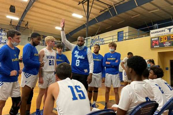 Hamshire-Fannett basketball coach Tigee Rideaux talks to his team during a home game. He decided Tuesday to take the same job at Aldine Nimitz.