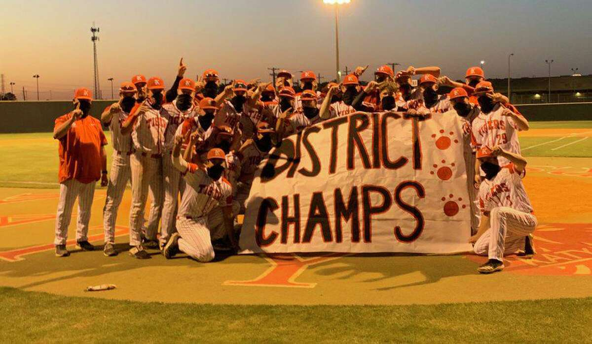 The Katy baseball team celebrates the District 19-6A championship after an 11-2 victory against Seven Lakes, April 20 at Katy High School. The Tigers improved to 24-3 overall.