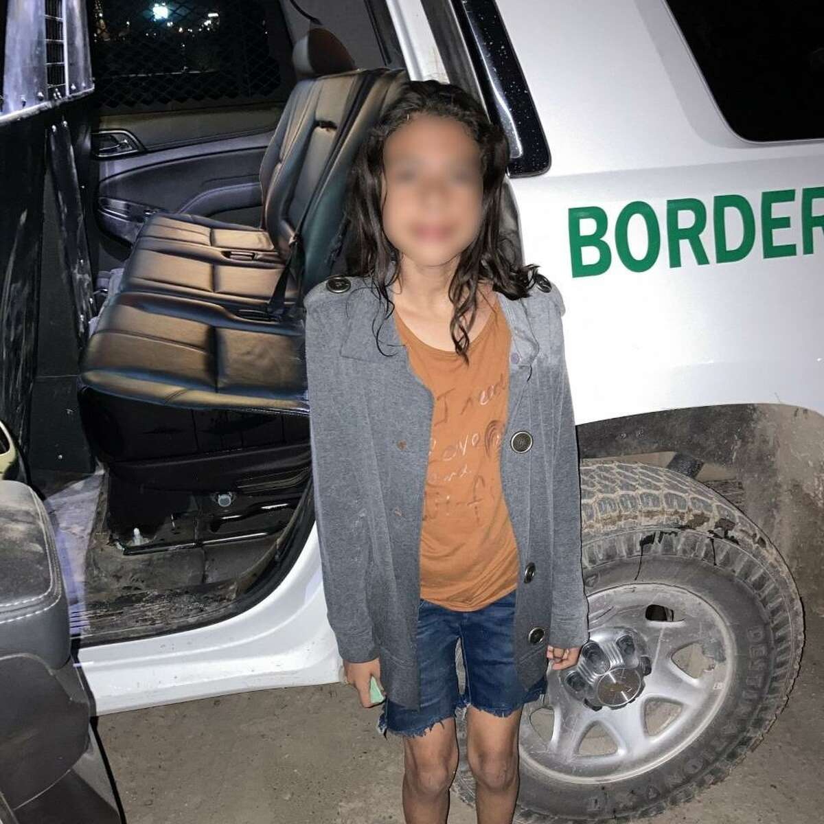 U.S. Border Patrol agents said smugglers abandoned this girl on the riverbanks as they returned to Mexico. An Army soldier rescued her after the soldier saw her struggling to get out of the river due to the swift river current and steep riverbank.