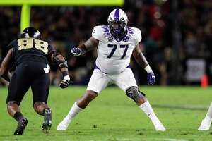 TCU offensive tackle Lucas Niang (77) plays against Purdue during the first half of an NCAA college football game in West Lafayette, Ind., Saturday, Sept. 14, 2019. (AP Photo/Michael Conroy)