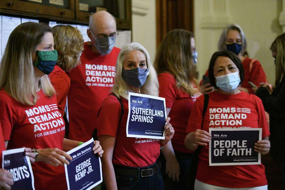 """A group called """"Moms Demand Action"""" gathers at the Texas Capitol to voice their opposition to permitless carry on Thursday, April 15, 2021, as the legislature considers the issue of the """"constitutional carry"""" of firearms that would allow those without handgun licenses to carry concealed pistols in public."""