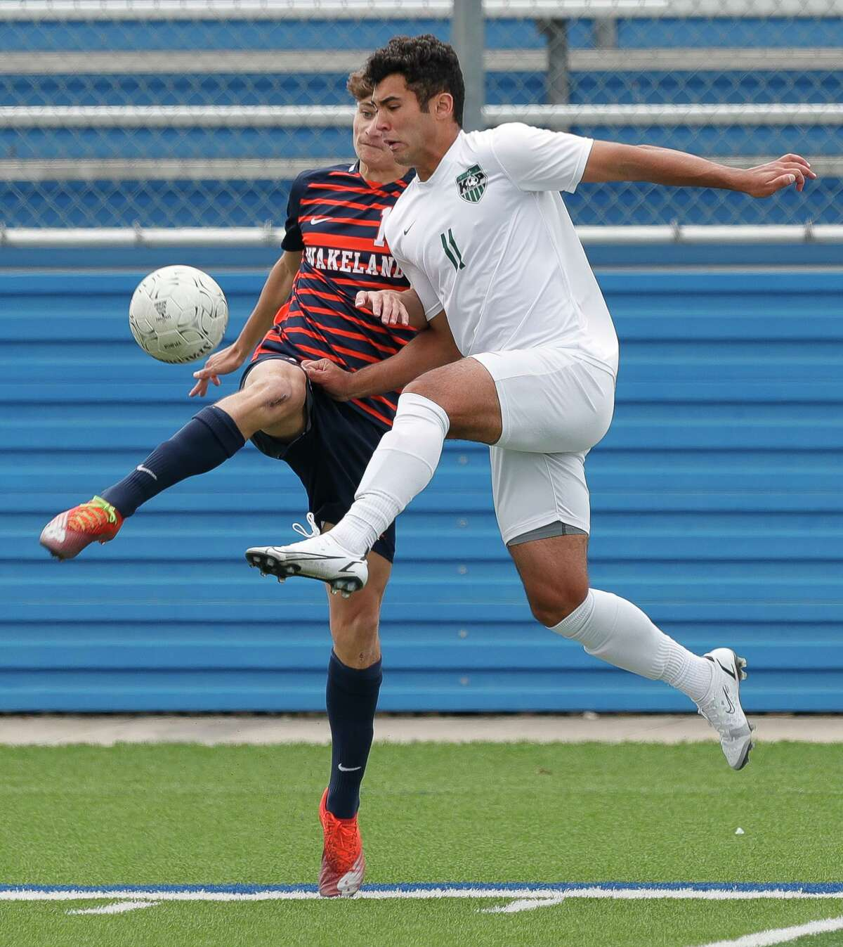 Kingwood Park forward Andrew Guerra (11) battles for the ball in the air against Frisco Wakeland midfielder Antony Quezada (14) in the first period of the UIL Class 5A boys soccer championship, Saturday, April 17, 2021, in Georgetown.