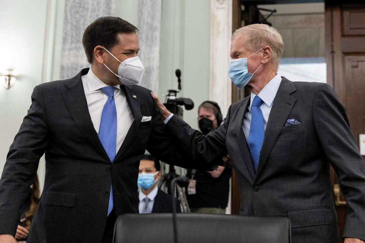 Former Sen. Bill Nelson, nominee to be administrator of NASA, greets Sen. Marco Rubio, R-Fla., prior to the start of a Senate Committee on Commerce, Science, and Transportation confirmation hearing, Wednesday, April 21, 2021 on Capitol Hill in Washington.
