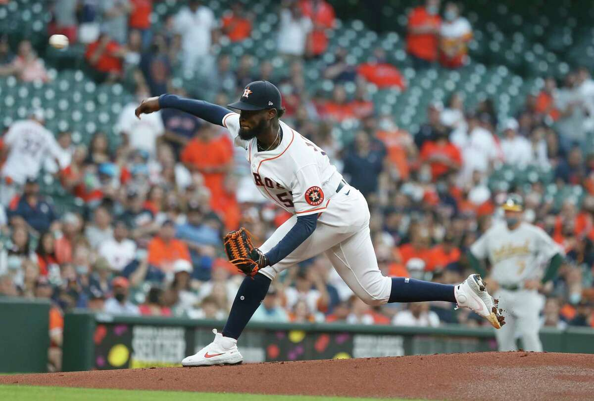 Houston Astros starting pitcher Cristian Javier (53) pitches during the first inning of the Astros home opener MLB baseball game at Minute Maid Park, in Houston, Thursday, April 8, 2021.