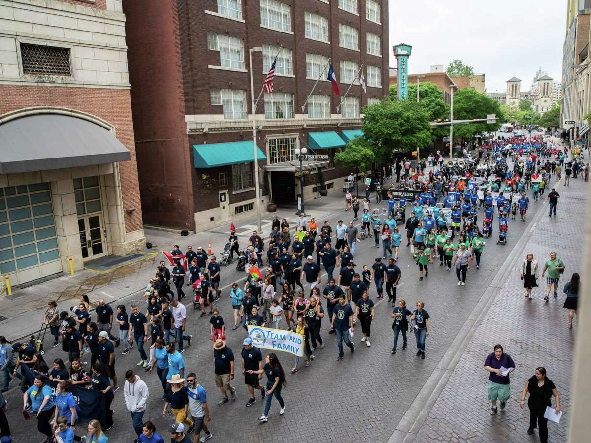 Marchers make their way into downtown San Antonio during the 23rd annual Cesar Chavez March on Thursday, March 28, 2019.