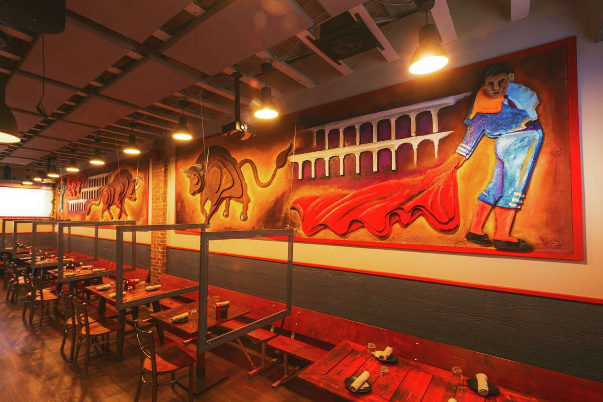 Hard-charging artwork by co-owner Stretch Altenhein adorns the walls.