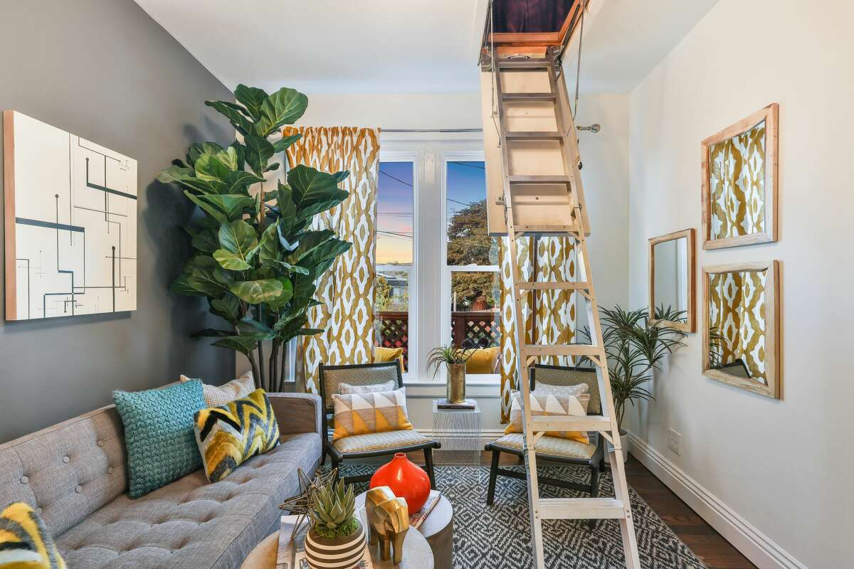 There is no stairway to this hangout heaven, just a pull-down ladder in the second bedroom/den.