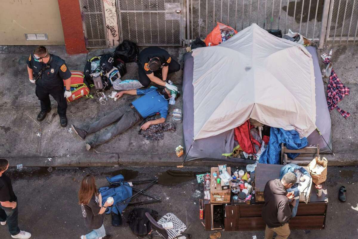 Paramedics work to revive an overdose victim in the Tenderloin in San Francisco last July.