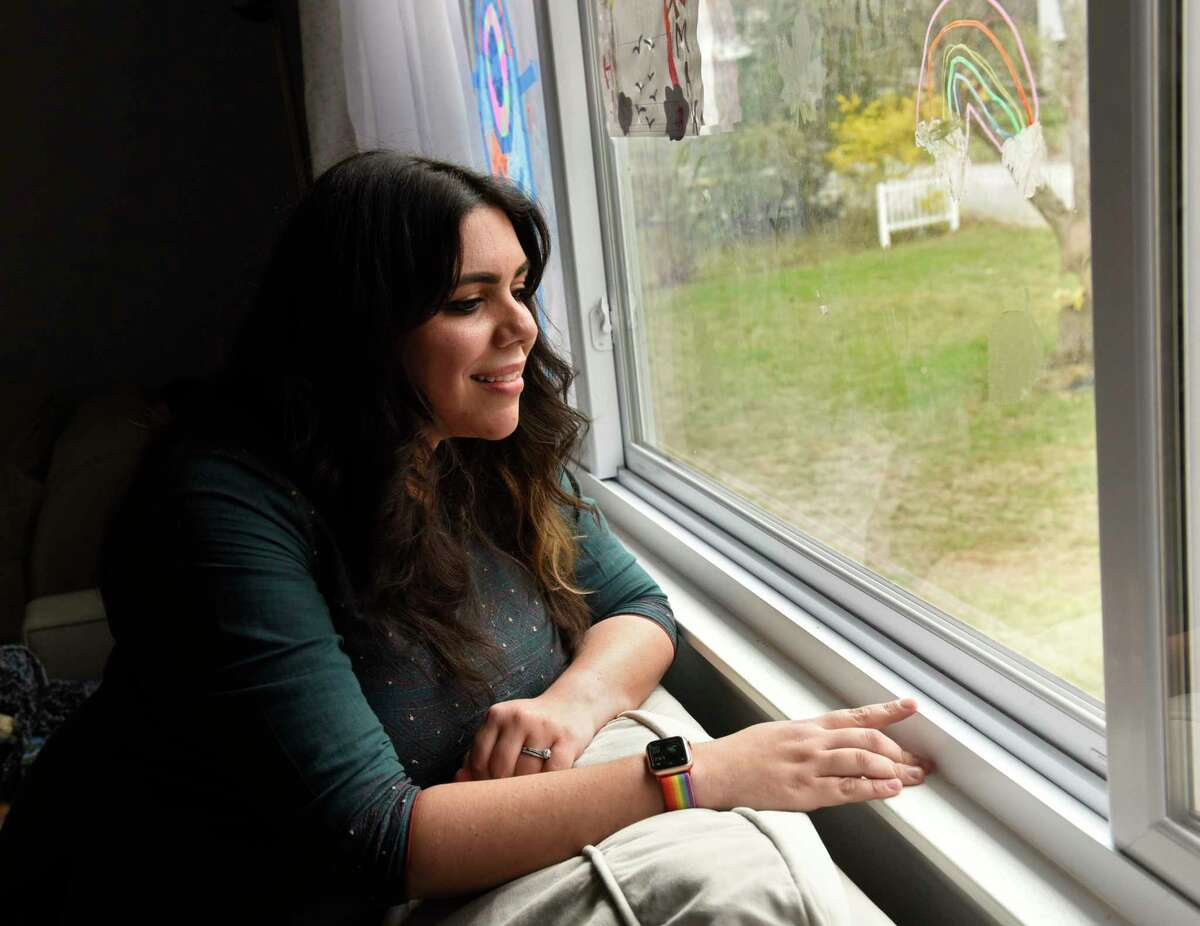 Natalya Lakhtakia watches her squirrels and chipmunks in her yard from her living room window on Tuesday, April 20, 2021 in Saratoga Springs, N.Y. Lakhtakia embraces the wildlife with miniature furniture where she feed them. (Lori Van Buren/Times Union)