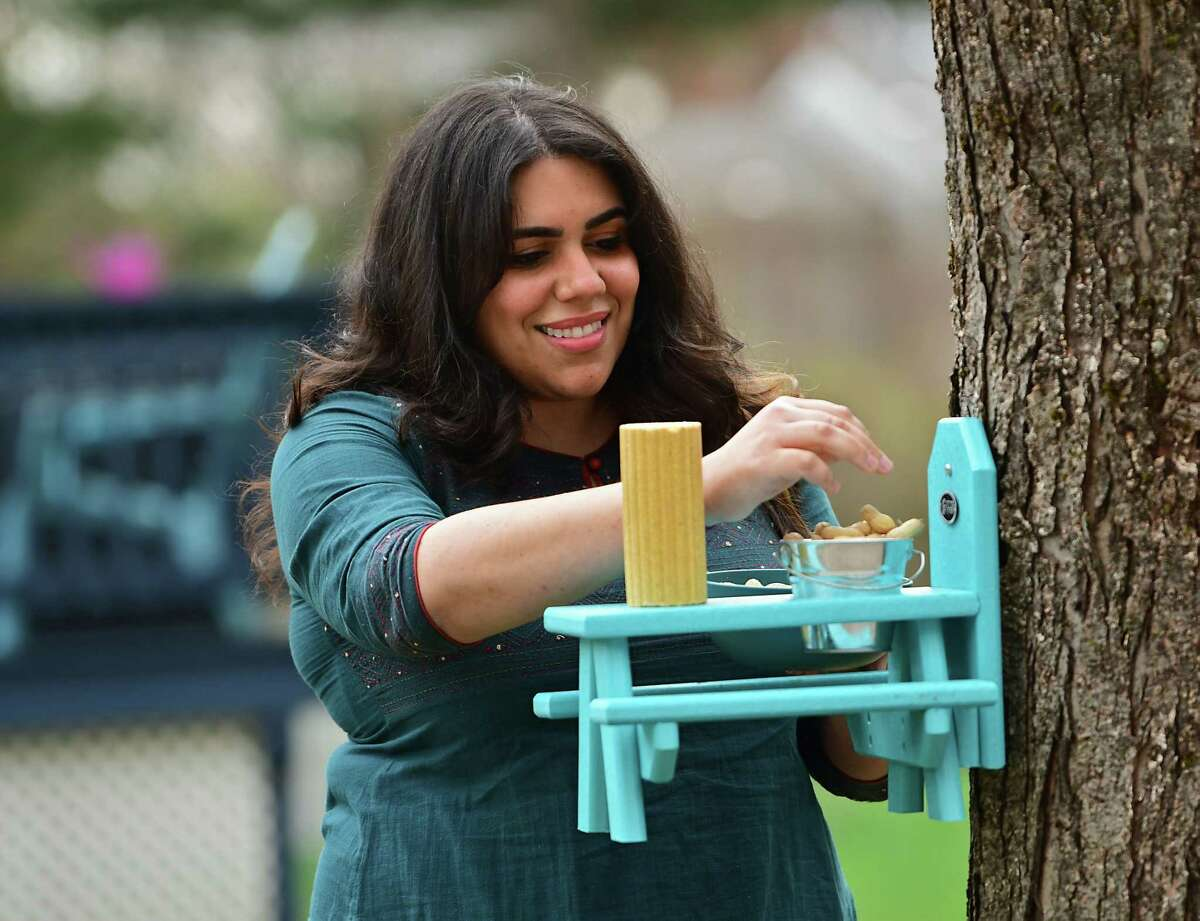 Natalya Lakhtakia embraces her squirrels and chipmunks with miniature furniture in her yard on Tuesday, April 20, 2021 in Saratoga Springs, N.Y. (Lori Van Buren/Times Union)