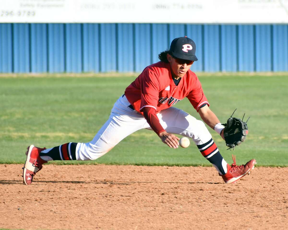 Plainview's Devin Rogers makes a play on a ground ball during a District 3-5A baseball game against Amarillo Caprock on Tuesday at Bulldog Park.