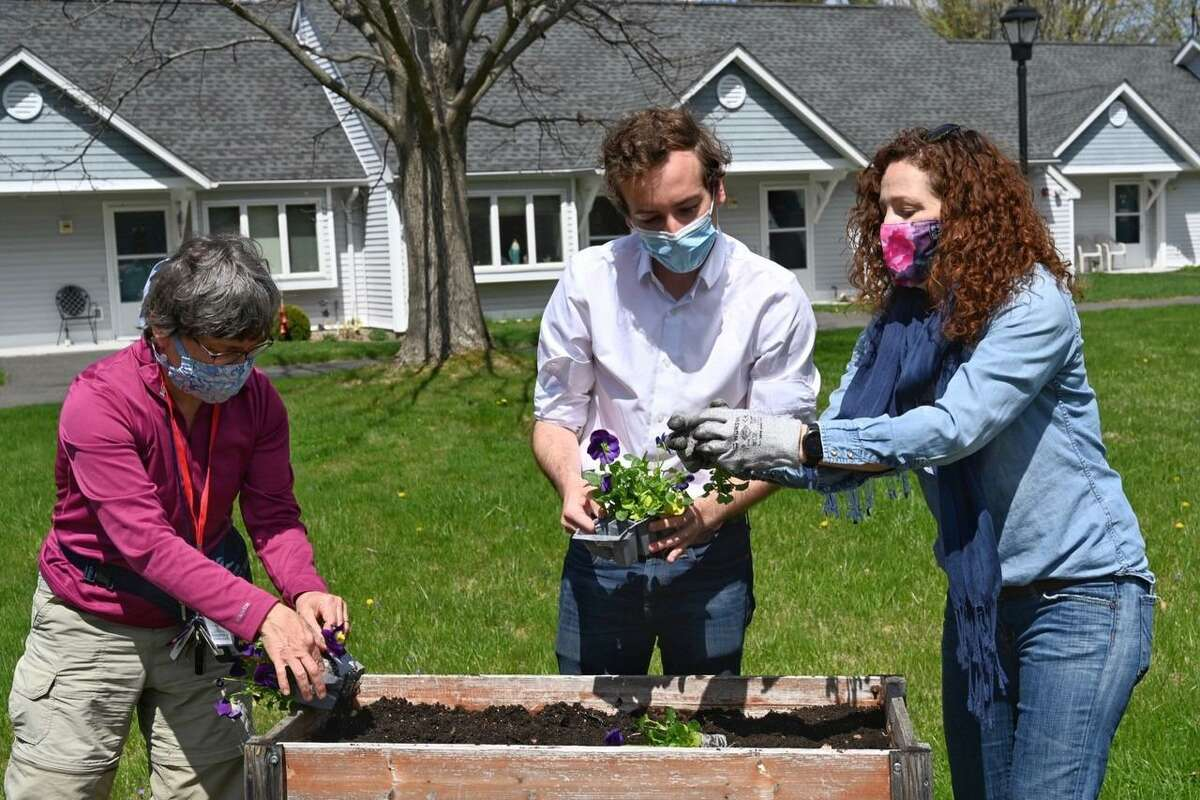 """Elected officials from Ridgefield joined more than 40 volunteers on April 18 to """"plant"""" democracy at Ballard Green Senior Housing in honor of Earth Day."""