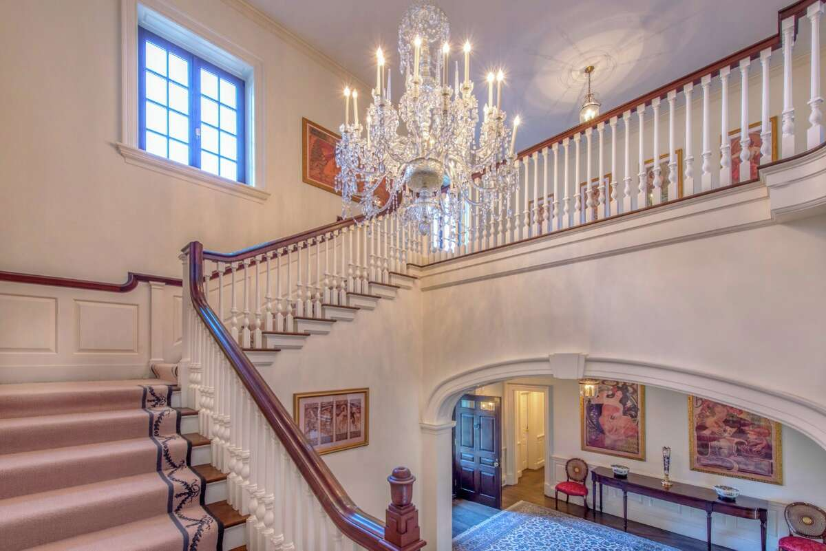 Listed for $16,450,000, Lendl'shome opens with a grand staircase and chandelier.
