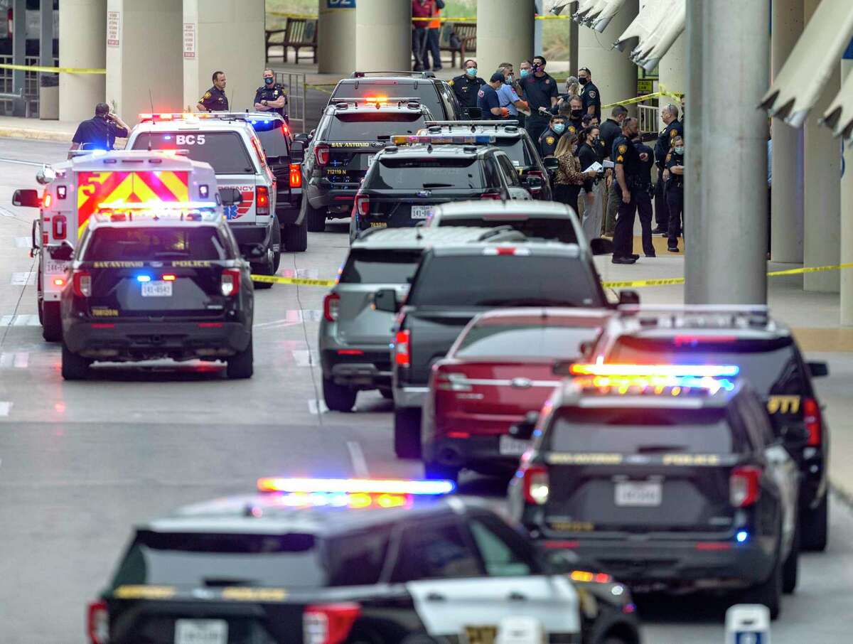Police respond to an active shooter at the San Antonio airport last week. A reader posits how a bill removing firearm requirements would have complicated matters.