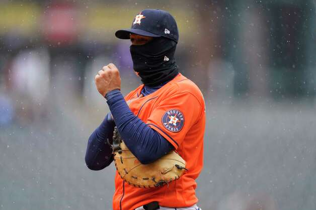 Houston Astros first baseman Yuli Gurriel struggles to keep warm in the second inning of a baseball game against the Colorado Rockies on Wednesday, April 21, 2021, in Denver. (AP Photo/David Zalubowski) Photo: David Zalubowski, Associated Press / Copyright 2021 The Associated Press. All rights reserved.