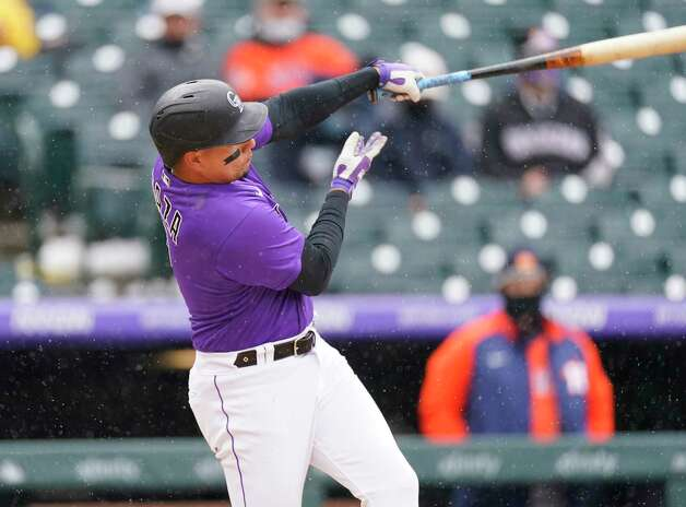 Colorado Rockies' Yonathan Daza connects for a solo home run off Houston Astros starting pitcher Jose Urquidy in the second inning of a baseball game Wednesday, April 21, 2021, in Denver. (AP Photo/David Zalubowski) Photo: David Zalubowski, Associated Press / Copyright 2021 The Associated Press. All rights reserved.